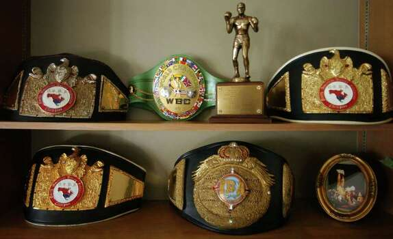 FOR SALIFE   - Detail photo of Jesse James Leija's trophy belts in his living room Sunday Feb. 27, 2005. PHOTO BY EDWARD A. ORNELAS/STAFF Photo: EDWARD A. ORNELAS, SAN ANTONIO EXPRESS-NEWS / SAN ANTONIO EXPRESS-NEWS