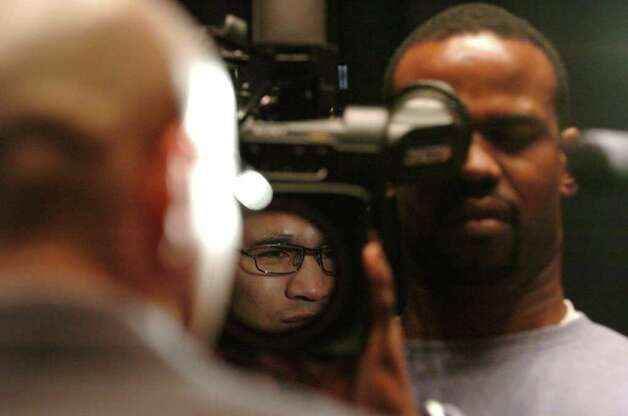 SPORTS - 'Jesse' James Leija is reflected in a video camera lens as he speaks about his retirement from professional boxing at Municipal Auditorium on Thursday, Feb. 3, 2005. BILLY CALZADA / STAFF Photo: BILLY CALZADA, SAN ANTONIO EXPRESS-NEWS / SAN ANTONIO EXPRESS-NEWS