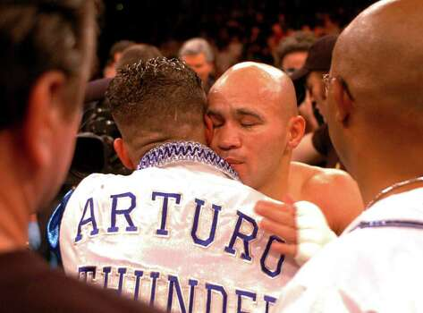 SPORTS - Jesse James Leija is embraced by Arturo Gatti after Gatti defeated him in the fifth round of their WBC super lightweight title fight in Atlantic City, N.J., on Saturday, Jan. 29, 2005. BILLY CALZADA / STAFF Photo: BILLY CALZADA, SAN ANTONIO EXPRESS-NEWS / SAN ANTONIO EXPRESS-NEWS