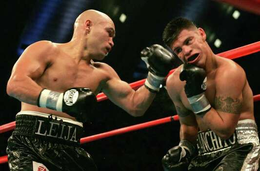 "Jesse James Leija, left, lands a left hook into Francisco ""Panchito"" Bojado  during the 10-round junior welterweight fight at Boardwalk Hall in Atlantic City, N.J. Saturday, July 24, 2004. Leija defeated Bojado.(AP Photo/Donna Conno)r Photo: DONNA CONNOR, AP / AP"