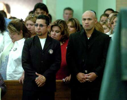 SPORTS- Boxers Mike Rios, left, and Jesse James Leija attend the funeral Mass of fellow boxer Robert Quiroga at Holy Rosary Catholic Church on Friday, Aug. 20, 2004. Quiroga was stabbed to death on Monday, Aug. 16. BILLY CALZADA / STAFF  FOR SPORTS Photo: BILLY CALZADA, SAN ANTONIO EXPRESS-NEWS / SAN ANTONIO EXPRESS-NEWS