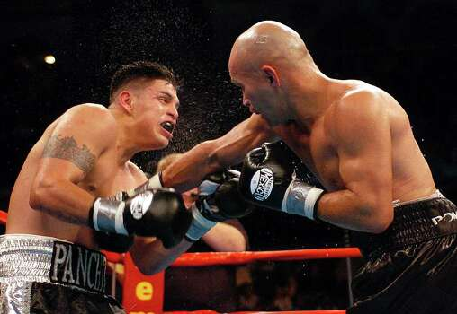 "SPORTS - ""Jesse"" James Leija lands a punch to the body of Francisco Bojado in the seventh round of their fight in Atlantic City on Saturday, July 24, 2004. Leija won the fight on a split decision. (Kin Man Hui/staff) Photo: KIN MAN HUI, SAN ANTONIO EXPRESS-NEWS / SAN ANTONIO EXPRESS-NEWS"