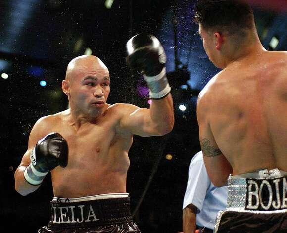 "SPORTS - ""Jesse"" James Leija lands a punch to the head of Francisco Bojado in the second round of their fight in Atlantic City on Saturday, July 24, 2004. Leija won the fight on a split decision. (Kin Man Hui/staff) Photo: KIN MAN HUI, SAN ANTONIO EXPRESS-NEWS / SAN ANTONIO EXPRESS-NEWS"