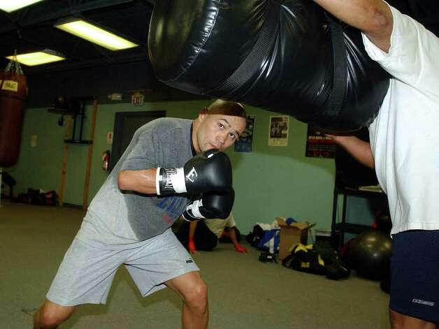 SPORTS - James Leija works out for an upcoming fight in Atlantic City on Wednesday, January 7, 2004.    (Kin Man Hui/staff) Photo: KIN MAN HUI, SAN ANTONIO EXPRESS-NEWS / SAN ANTONIO EXPRESS-NEWS