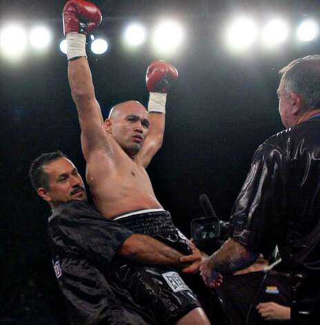 "Jesse James Leija celebrates beating Fernado Mena during round two of the ""Clash of the Titans"" main event Saturday, November 15, 2003 at the Alamodome in San Antonio, Texas. NICOLE FRUGE/SAN ANTONIO EXPRESS-NEWS Photo: Nicole Fruge, San Antonio Express-News / San Antonio Express-News"