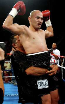 "SPORTS   ---   ""Jesse"" James Leija is lifted into the air Nov. 15, 2003 at the Alamodome after knocking out Fernando Mena during the co-main event of HBO's Clash of the Titans with 2:03 left in the second round.      (WILLIAM LUTHER/STAFF) Photo: WILLIAM LUTHER, SAN ANTONIO EXPRESS-NEWS / SAN ANTONIO EXPRESS-NEWS"