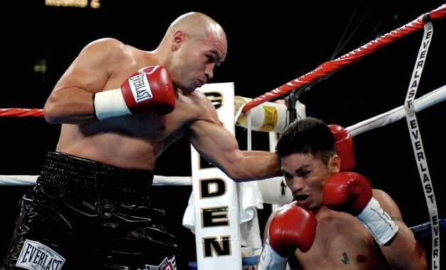 "SPORTS   ---   ""Jesse"" James Leija lands the punch on Fernando Mena Nov. 15, 2003 at the Alamodome that knocked him out during the co-main event of HBO's Clash of the Titans with 2:03 left in the second round.      (WILLIAM LUTHER/STAFF) Photo: WILLIAM LUTHER, SAN ANTONIO EXPRESS-NEWS / SAN ANTONIO EXPRESS-NEWS"