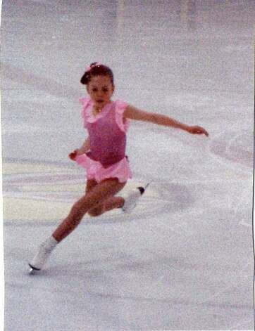 "Lucinda Ruh enters an axel jump at eleven years old in Tokyo, Japan. ""Again my own designed costume,"" she says. Photo: Contributed Photo / Greenwich Citizen"