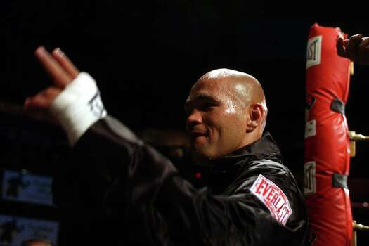 SPORTS - James Leija acknowldedges the crowd as he leaves the ring following his fourth round knockout of Adan Casillas Thursday, May 22, 2003 at the SBC Center. BAHRAM MARK SOBHANI/STAFF Photo: BAHRAM MARK SOBHANI, SAN ANTONIO EXPRESS-NEWS / SAN ANTONIO EXPRESS NEWS