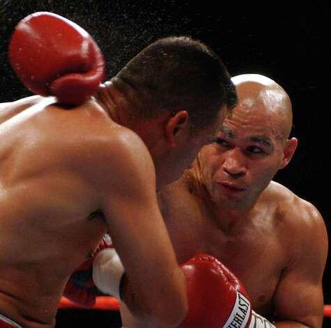 SPORTS - James Leija lands a rabbit punch on Adan Casillas in the third round during their fight Thursday, May 22, 2003 at the SBC Center. Leija won by knockout in the fourth round. BAHRAM MARK SOBHANI/STAFF Photo: BAHRAM MARK SOBHANI, SAN ANTONIO EXPRESS-NEWS / SAN ANTONIO EXPRESS NEWS
