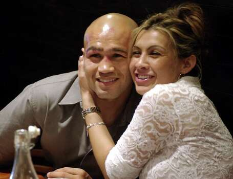 "SPORTS   ---   Lisa Leija hugs her husband""Jesse"" James Leija during a post-fight dinner Sunday night Jan. 19, 2003 in Melbourne, Australia for Leija's family and training staff after Leija lost his fight against world title holder Kostya Tszyu at the Telstra Dome.   (WILLIAM LUTHER/STAFF) Photo: WILLIAM LUTHER, SAN ANTONIO EXPRESS-NEWS / SAN ANTONIO EXPRESS-NEWS"