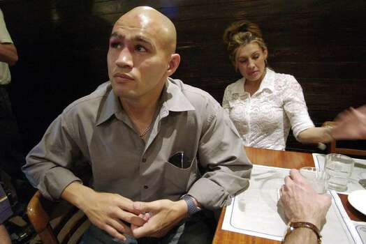 "SPORTS   ---   ""Jesse"" James Leija has dinner with his family and his camp Sunday night Jan. 19, 2003 in Melbourne, Australia after losing his fight against world title holder Kostya Tszyu at the Telstra Dome.   (WILLIAM LUTHER/STAFF) Photo: WILLIAM LUTHER, SAN ANTONIO EXPRESS-NEWS / SAN ANTONIO EXPRESS-NEWS"