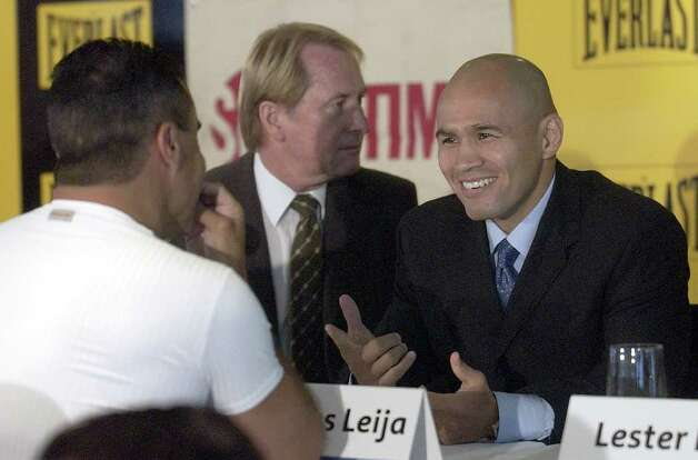 "SPORTS   ---   ""Jesse"" James Leija, right, talks Thursday January 16, 2003 at the Telstra Dome in Melbourne, Australia with famous Australian boxer Jeff Fenech (cq) before a press conference to discuss Leija's Sunday afternoon fight against the Kostya Tszyu for the undisputed  IBF, WBA, and WBC super lightweight titles. At center is Australian promoter Glenn Wheatley (cq).   (WILLIAM LUTHER/STAFF) Photo: WILLIAM LUTHER, SAN ANTONIO EXPRESS-NEWS / SAN ANTONIO EXPRESS-NEWS"