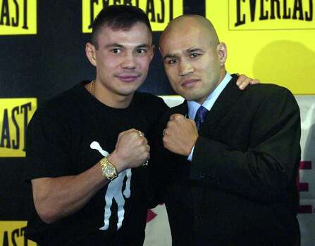 "SPORTS   ---   Kostya Tszyu, left, and ""Jesse"" James Leija pose during a press conference Thursday January 16, 2003 at the Telstra Dome in Melbourne, Australia in advance of their IBF, WBA, WBC world super lightweight championship fight Sunday afternoon.   (WILLIAM LUTHER/STAFF) Photo: WILLIAM LUTHER, SAN ANTONIO EXPRESS-NEWS / SAN ANTONIO EXPRESS-NEWS"