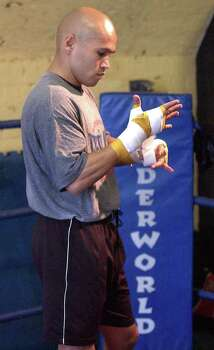 "SPORTS   ---   ""Jesse"" James Leija tapes his hands before his workout Tuesday Jan. 14, 2002 at the Underworld Gym in Melbourne, Australia as he prepares for his world title fight against Kostya Tzsyu at the Telstra Dome.   (WILLIAM LUTHER/STAFF) Photo: WILLIAM LUTHER, SAN ANTONIO EXPRESS-NEWS / SAN ANTONIO EXPRESS-NEWS"