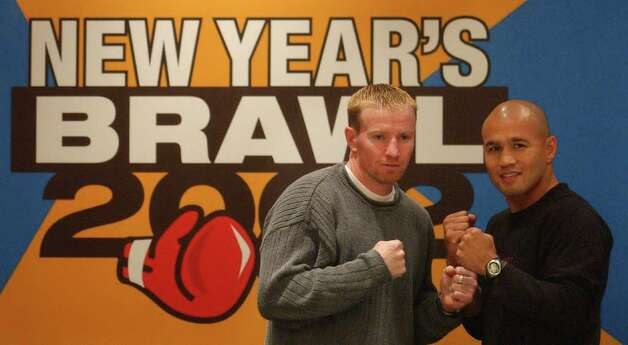 "SPORTS/DAILY/STAFF PHOTO BY WILLIAM LUTHER   ---   Micky Ward, left, and ""Jesse"" James Leija, seen at a press conference Wednesday afternoon Nov. 28, 2001 at the Adam's Mark Hotel, will face each other January 5, 2001 at Freeman Coliseum. Photo: WILLIAM LUTHER, SAN ANTONIO EXPRESS-NEWS"