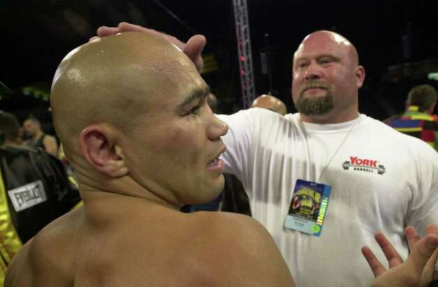 "FOR SPORTS DAILY - Personal trainer Ed Cosner rubs Jesse James Leija's head after Hector ""Macho"" Camacho, Jr. was unanimously declared the technical winner just before the sixth round Saturday July 7, 2001 at KeySpan Park in Coney Island, Brooklyn, NY during their 10 Round Super Lightweight Bout. PHOTO BY EDWARD A. ORNELAS/STAFF Photo: EDWARD A. ORNELAS, EN / EN"