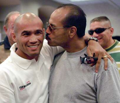 "Tony Ayala, Jr.,  right, kisses his rival Jesse ""James"" Leija Thursday Aug. 19, 1999 before the weigh-ins at the Radisson Hotel in San Antonio. Ayala had called Leija a ""coward,"" but late apologized.(EXPRESS-NEWS PHOTO/JOE CAVARETTA) Photo: JOE CAVARETTA, EN / EN"