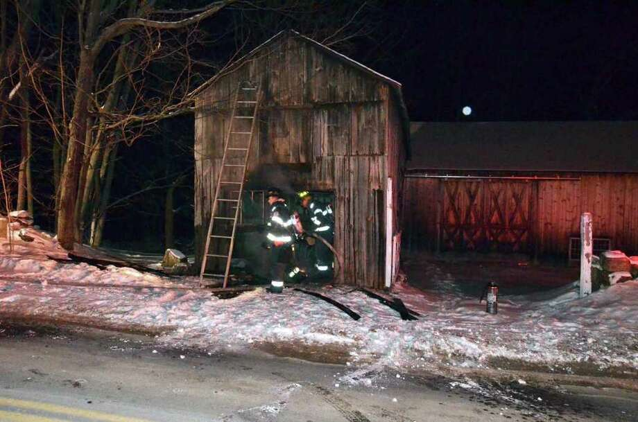 On February 22nd at 01:07am the Danbury Fire Department received two 911 reports of a barn on fire at 65 King Street. Engine 25 from the South King Street station arrived very quickly to find an old barn with an outside wall on fire. The fire was quickly extinguished by Engine 25, with the assistance of a Tanker Truck from the King Street Volunteer Fire Company. Additional Firefighters from New Street were on the scene to assist, while other Danbury Volunteer Fire Companies stood by in case they were needed. According to property records, the barn is owned by Jonathan and Jennifer Kuczwaj.  Firefighters were on the scene for about 1 hour, and the Danbury Fire Marshals Office and Danbury Police are investigating.  Report filed by Captain Bernie Meehan/Incident Commander. Photo: Contributed Photo / The News-Times Contributed