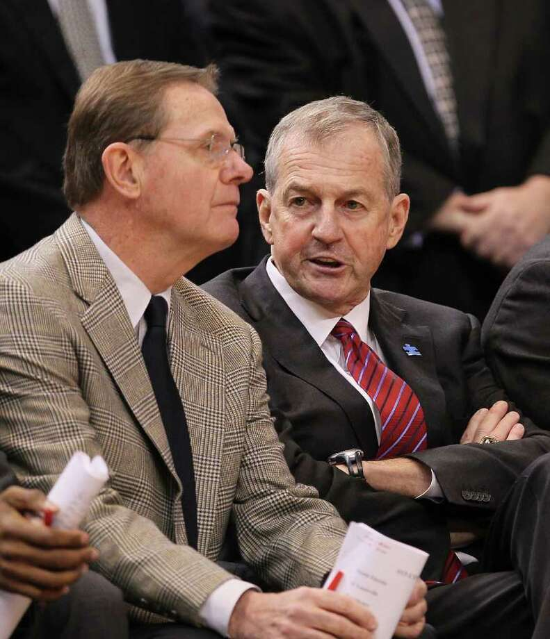 UConn basketball coach Jim Calhoun with assistant coach George Blaney during a game against the Cincinnati Bearcats at the XL Center on February 13, 2010 in Hartford, Conn. The NCAA Committee on Infractions found that Calhoun failed to promote an atmosphere of compliance during the recruitment of Nate Miles and suspended him for the first three Big East games next season. Photo: Jim Rogash, Jim Rogash/Getty Image / 2010 Getty Images