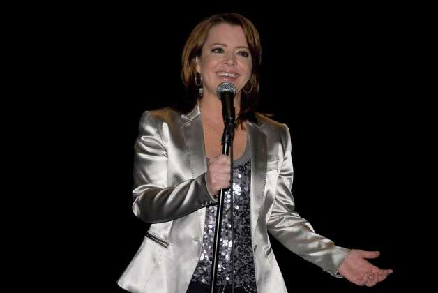 Comic Kathleen Madigan will bring her stand-up act to the Fairfield University Quick Center, Friday, Feb. 25. A frequent guest on 'The Tonight Show with Jay Leno,' and 'The Late Show with David Letterman,' she has been performing on stage for more than 20 years. Contributed photo/Traci Gilland/ICONYC Photo: Contributed Photo / Stamford Advocate Contributed