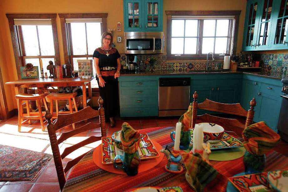 """The colorful kitchen makes Cary Atkins """"happy every morning when I walk in here."""" Photo: KIN MAN HUI, SAN ANTONIO EXPRESS-NEWS / San Antonio Express-News"""