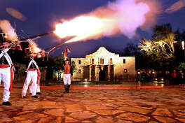 Members of the San Antonio Living History Association, dressed as Mexican soldiers, take part in a memorial service at Alamo Plaza. EXPRESS-NEWS FILE PHOTO