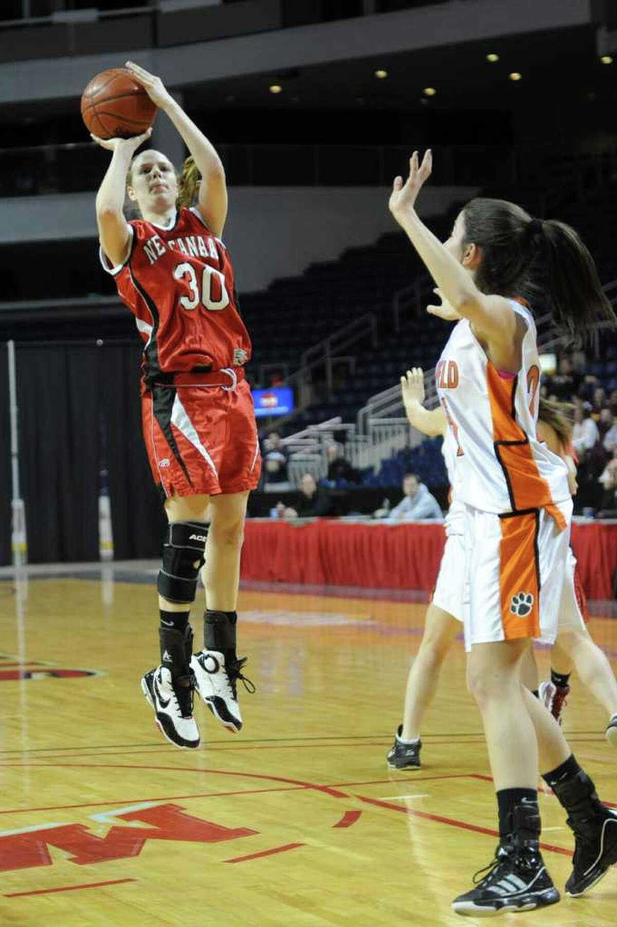 New Canaan's Melissa Tweed takes a shot during Tuesday's FCIAC girls basketball semifinal game at the Webster Bank Arena at Harbor Yard on Feburary 22, 2011.