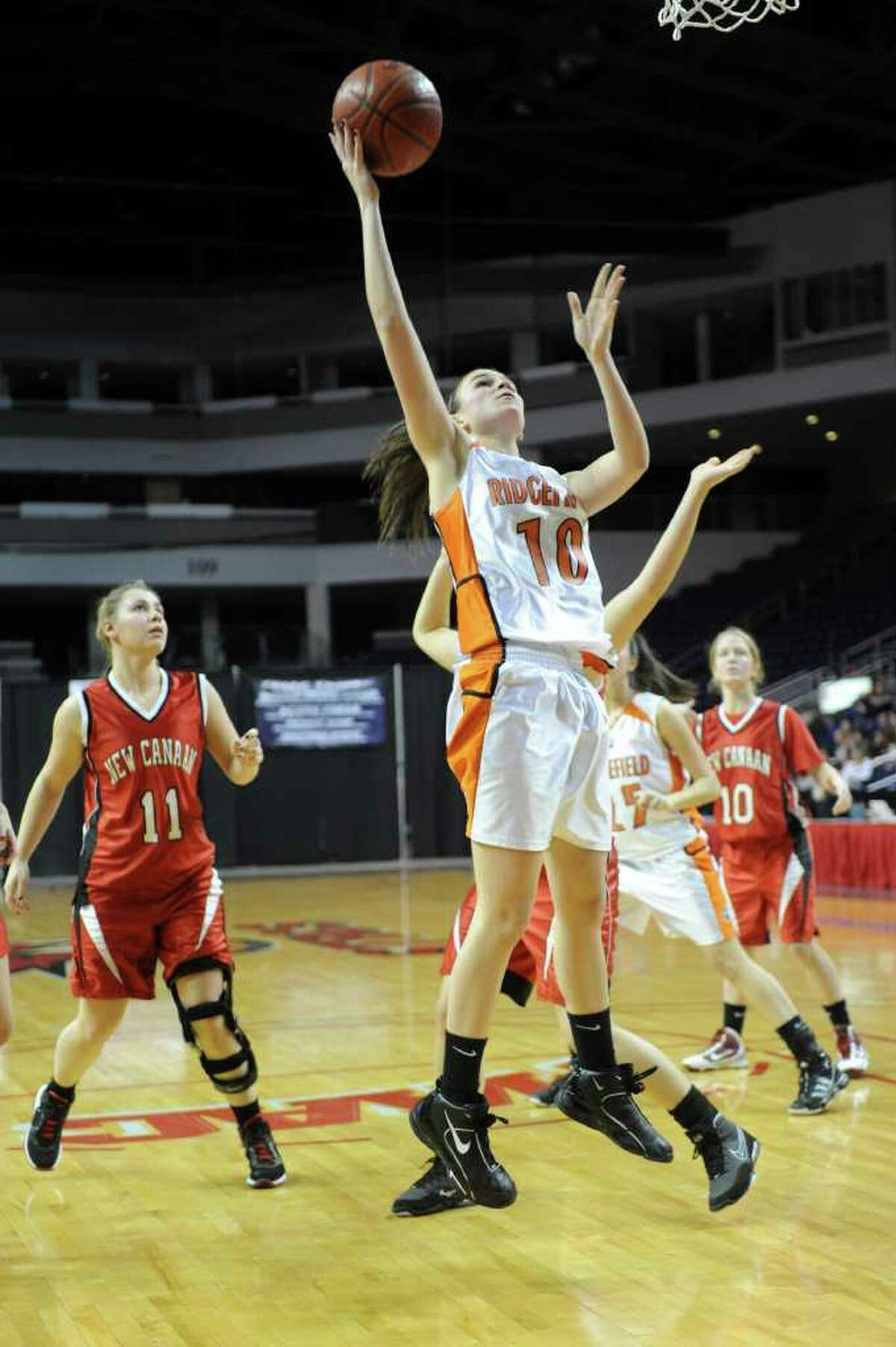 Ridgefield's Kathryn Cholko takes a shot during Tuesday's FCIAC girls basketball semifinal game at the Webster Bank Arena at Harbor Yard on Feburary 22, 2011.