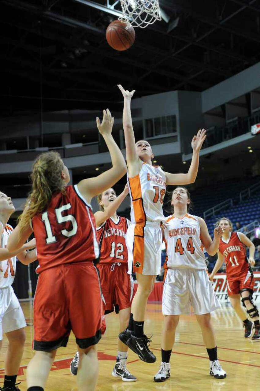 Ridgefield's Kathryn Cholko puts up a shot during Tuesday's FCIAC girls basketball semifinal game at the Webster Bank Arena at Harbor Yard on Feburary 22, 2011.