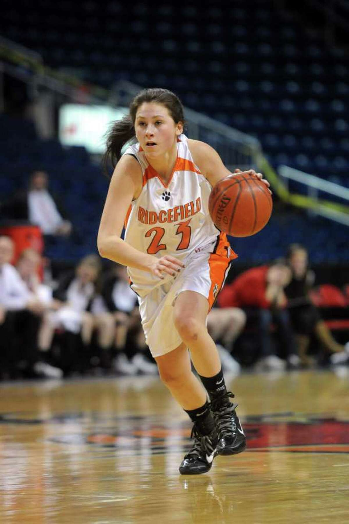 Emily Favorite dribbles for Ridgefield during Tuesday's FCIAC girls basketball semifinal game at the Webster Bank Arena at Harbor Yard on Feburary 22, 2011.