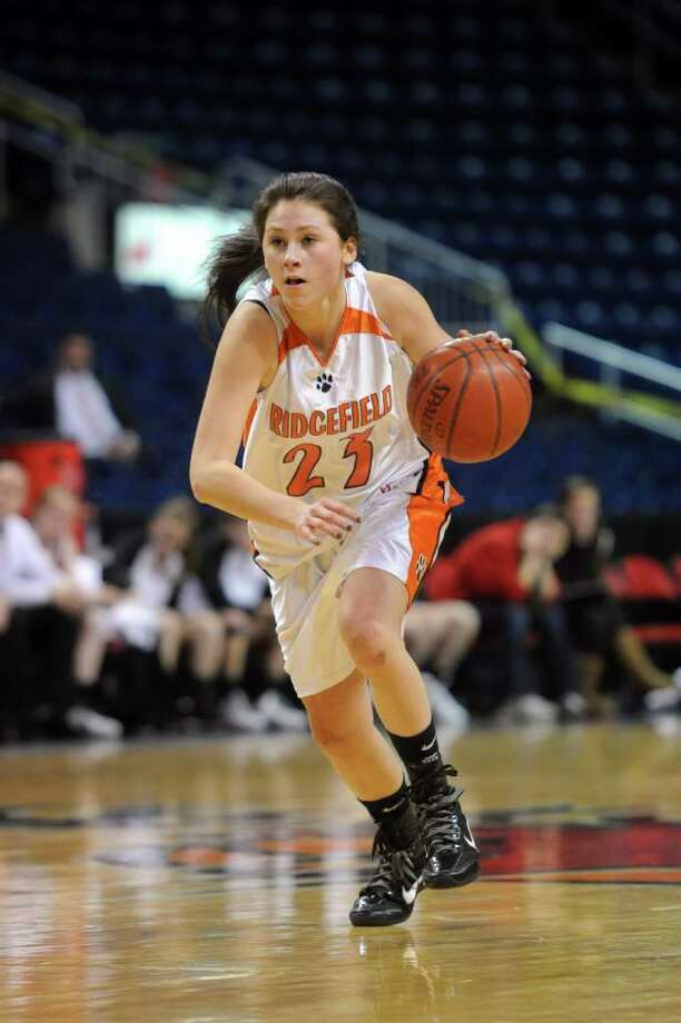 Emily Favorite dribbles for Ridgefield during Tuesday's FCIAC girls basketball semifinal game at the Webster Bank Arena at Harbor Yard on Feburary 22, 2011. Photo: Lindsay Niegelberg / Connecticut Post