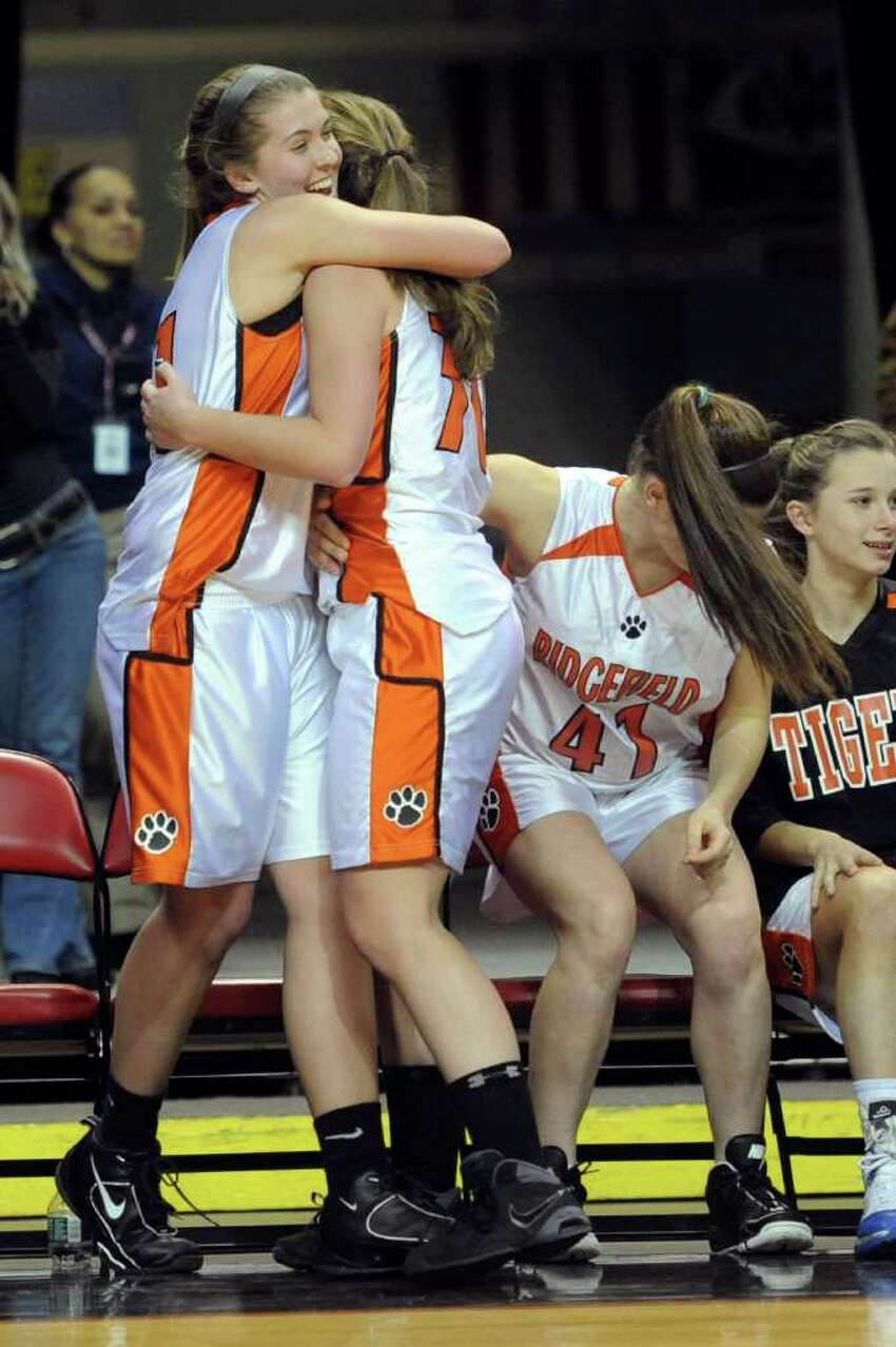 The Ridgefield bench celebrates a win after Tuesday's FCIAC girls basketball semifinal game at the Webster Bank Arena at Harbor Yard on Feburary 22, 2011.
