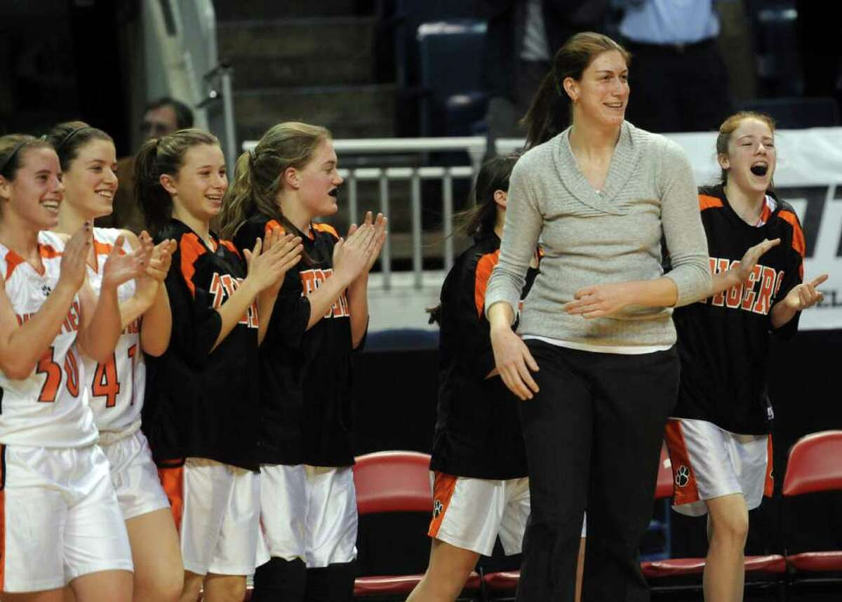 Ridgefield's bench and coach Katie Smith celebrate winning Tuesday's FCIAC girls basketball semifinal game at the Webster Bank Arena at Harbor Yard on Feburary 22, 2011.