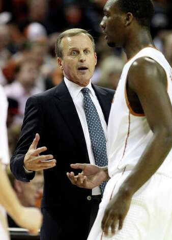 Texas Longhorns head coach Rick Barnes (center) talks to his player, Jordan Hamilton, during a timeout against Iowa State in men's basektball in the second half in Austin on Tuesday, Feb. 22, 2011. The Longhorns defeated Iowa State, 76-53. Kin Man Hui/kmhui@express-news.net Photo: KIN MAN HUI, Kin Man Hui/kmhui@express-news.net / San Antonio Express-News