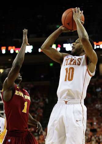 Texas Longhorns' Jai Lucas (10) takes a jump shot against Iowa State's Bubu Palo (01) in men's basektball in the second half in Austin on Tuesday, Feb. 22, 2011. The Longhorns defeated Iowa State, 76-53. Kin Man Hui/kmhui@express-news.net Photo: KIN MAN HUI, Kin Man Hui/kmhui@express-news.net / San Antonio Express-News