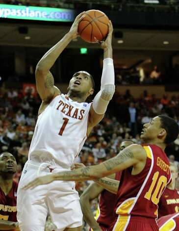 Texas Longhorns' Gary Johnson (01) goes for a shot against Iowa State's Diante Garrett (10) in men's basektball in the second half in Austin on Tuesday, Feb. 22, 2011. The Longhorns defeated Iowa State, 76-53. Kin Man Hui/kmhui@express-news.net Photo: KIN MAN HUI, Kin Man Hui/kmhui@express-news.net / San Antonio Express-News
