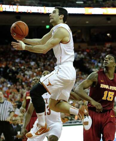 Texas Longhorns' Dogus Balbay (center) drives past Iowa State's Calvin Godfrey (15) in men's basektball in the second half in Austin on Tuesday, Feb. 22, 2011. The Longhorns defeated Iowa State, 76-53. Kin Man Hui/kmhui@express-news.net Photo: KIN MAN HUI, Kin Man Hui/kmhui@express-news.net / San Antonio Express-News