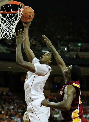 Texas Longhorns' Tristan Thompson (left) takes a shot against Iowa State's Calvin Godfrey (right) in men's basektball in the second half in Austin on Tuesday, Feb. 22, 2011. The Longhorns defeated Iowa State, 76-53. Kin Man Hui/kmhui@express-news.net Photo: KIN MAN HUI, Kin Man Hui/kmhui@express-news.net / San Antonio Express-News