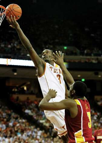 Texas Longhorns' Jordan Hamilton (03) lays up a shot against Iowa State's Melvin Ejim (03) in men's basektball in the second half in Austin on Tuesday, Feb. 22, 2011. The Longhorns defeated Iowa State, 76-53. Kin Man Hui/kmhui@express-news.net Photo: KIN MAN HUI, Kin Man Hui/kmhui@express-news.net / San Antonio Express-News
