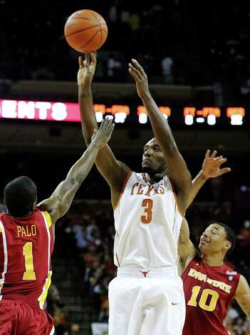 Texas Longhorns' Jordan Hamilton (03) takes a jumper against Iowa State's Bubu Palo (01) and Diante Garrett (10) in the first half in men's basektball in Austin on Tuesday, Feb. 22, 2011. Kin Man Hui/kmhui@express-news.net Photo: KIN MAN HUI, Kin Man Hui/kmhui@express-news.net / San Antonio Express-News