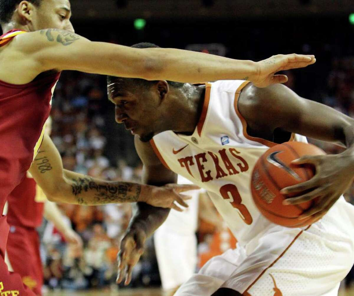 Texas Longhorns' Jordan Hamilton (03) attempts to drive to the basket against Iowa State's Diante Garrett (10) in the first half in men's basektball in Austin on Tuesday, Feb. 22, 2011. Kin Man Hui/kmhui@express-news.net