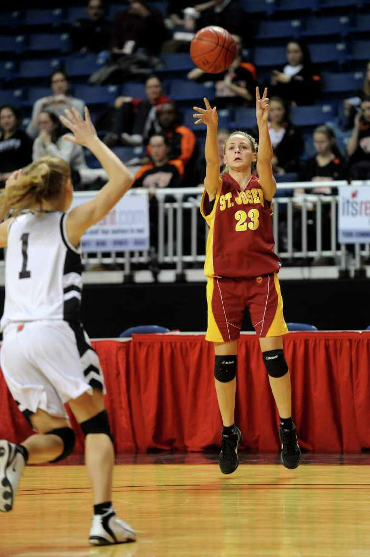 St. Joseph's Taylor Whiting takes a shot during Tuesday's FCIAC girls basketball semifinal game at the Webster Bank Arena at Harbor Yard on Feburary 22, 2011.
