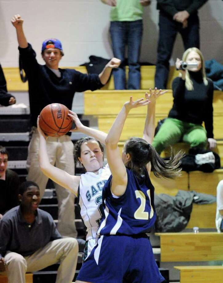 Kayla Souza of Convent of the Sacred Heart, left, is covered by King's Molly Goldstein, # 25, right, during the closing seconds of the King vs. Convent of the Sacred Heart, girls varsity basketball game, at King, Tuesday night, Feb. 22, 2011.  King of Stamford defeated Convent of the Sacred Heart of Greenwich, 27-26 to advance in the FAA playoffs. Photo: Bob Luckey / Greenwich Time
