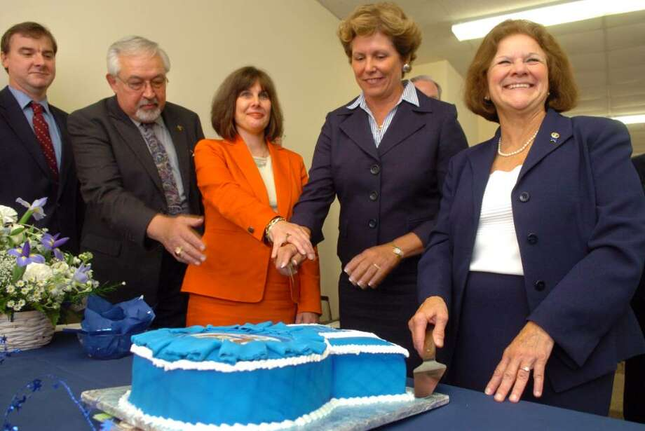 Principals from the five Blue Ribbon winning schools of the Roman Catholic Diocese of Bridgeport get ready to cut the blue ribbon shaped cake Tuesday Sept. 15, 2009 at The Catholic Center in Bridgeport, CT.  Pictured are Gene Holmes, principal of St. Marks Catholic School in Stratford, former St. Marks principal Philip Adzima, Patrice Kopas principal of Greenwich Catholic School, Mary Maloney, principal of St. Rose of Lima Catholic School in Newtown, and Dr. Margaret Dames, superintendent of schools for the diocese, from left. Photo: Autumn Driscoll / Connecticut Post