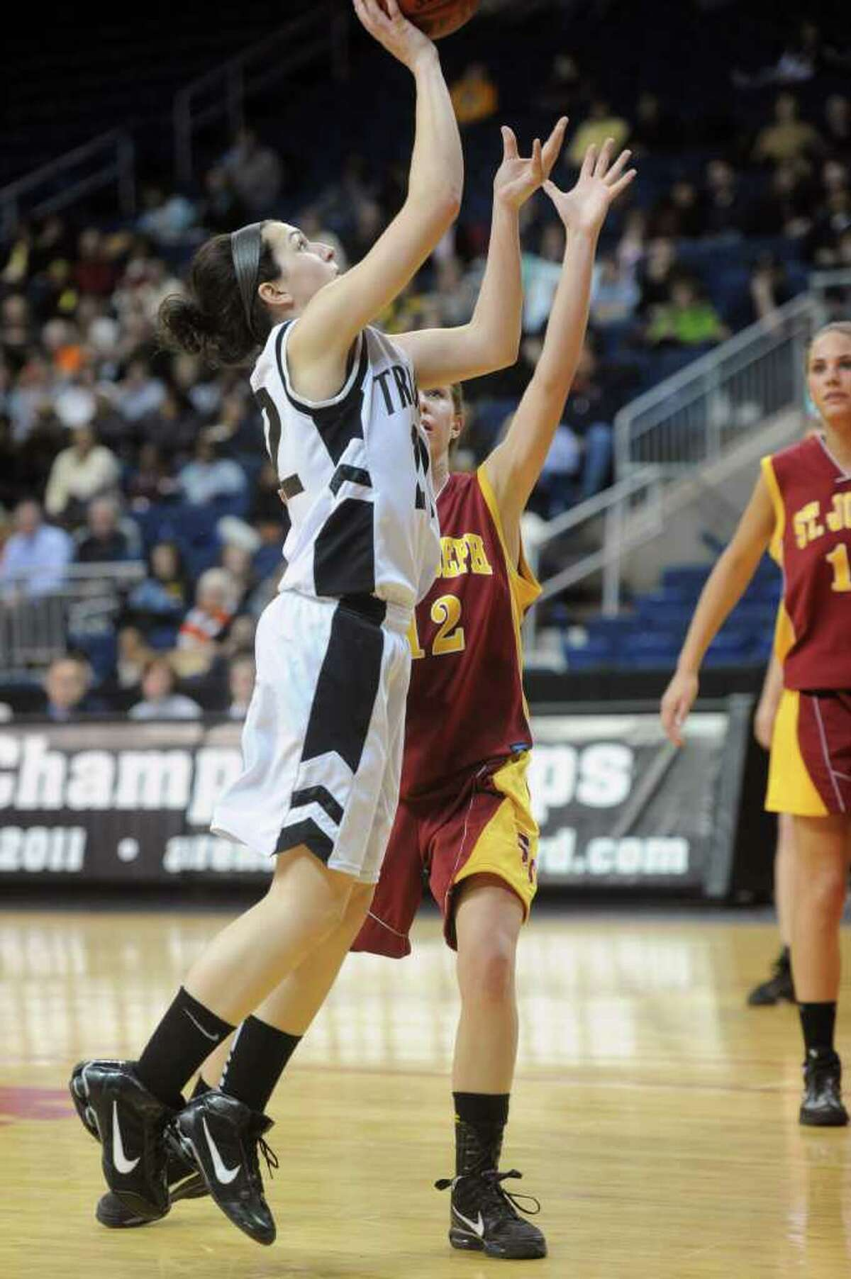 Trumbull's Kelly Coughlin takes a shot during Tuesday's FCIAC girls basketball semifinal game at the Webster Bank Arena at Harbor Yard on Feburary 22, 2011.