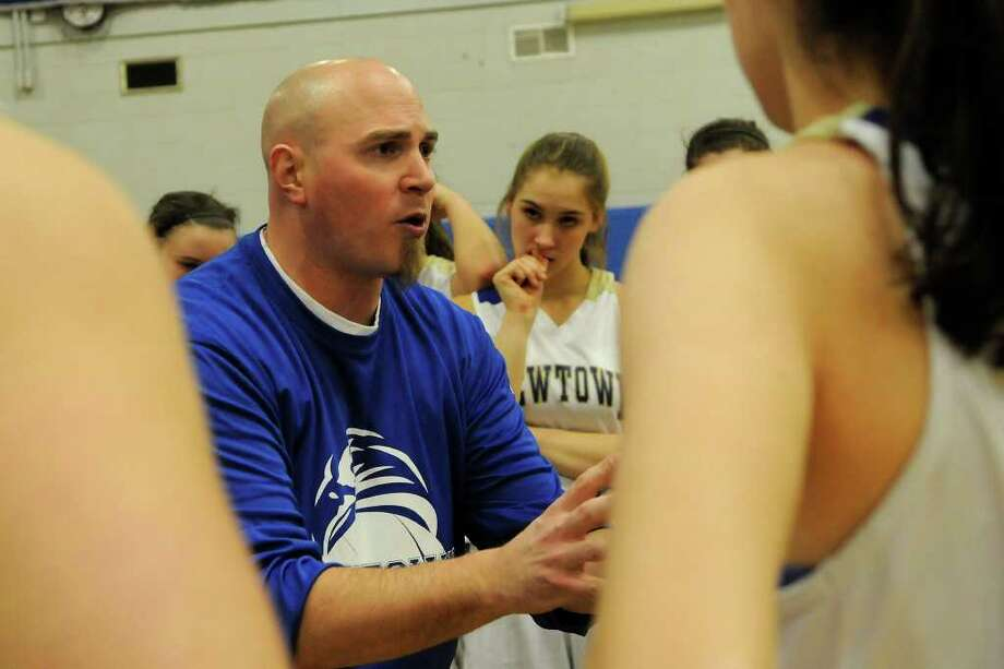 Newtown coach Jeremy O'Connell instructs the team as Brookfield High School challenges Newtown High School in the semifinals of the Southwest Conference Girls Basketball Tournament at Bunnell High School in Stratford, CT on Tuesday, February 22, 2011. Photo: Shelley Cryan / Shelley Cryan