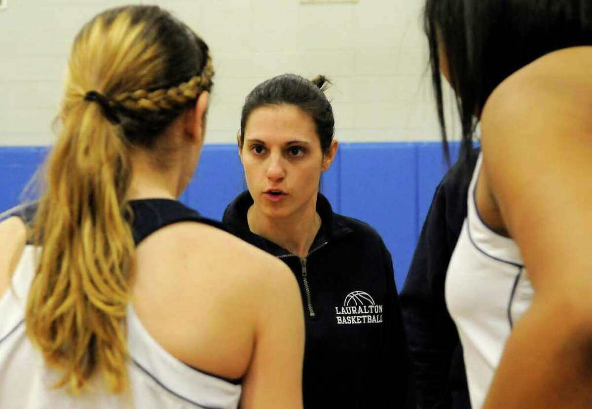 Lauralton Hall coach Alessa Laczkoski gives instruction to the team as Pomperaug High School challenges Lauralton Hall High School in the semifinals of the Southwest Conference Girls Basketball Tournament at Bunnell High School in Stratford, CT on Tuesday, February 22, 2011.
