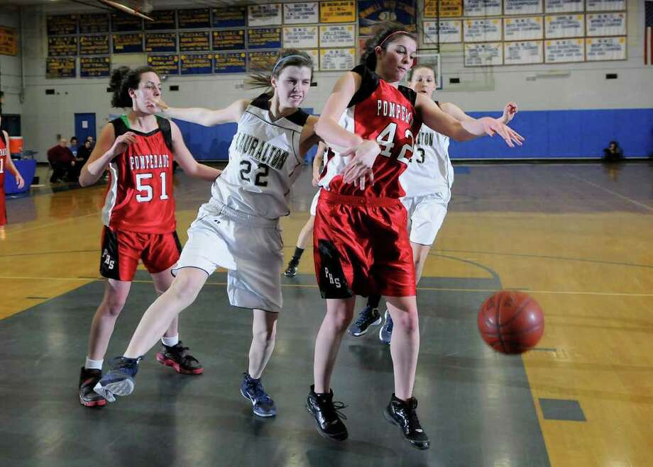 Lauralton #22 Erin Montanez and Pomperaug #42 Allison Wallace go after a loose ball as Pomperaug High School challenges Lauralton Hall High School in the semifinals of the Southwest Conference Girls Basketball Tournament at Bunnell High School in Stratford, CT on Tuesday, February 22, 2011. Photo: Shelley Cryan / Shelley Cryan