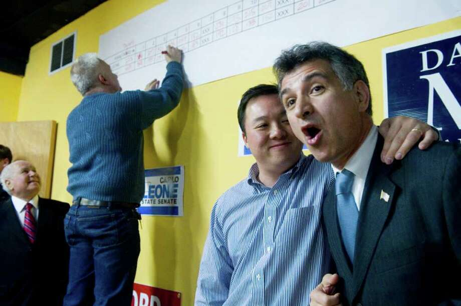 Carlo Leone is congratulated by State Representative William Tong after winning the state senate race in the special election at the Democratic Headquarters on High Ridge Road in Stamford, Conn., February 22, 2011. Democrat Leone beat Republican Bob Koenberg in the race for state senate after Andrew McDonald vacated it to join Governor Dannel Malloy as general council. Photo: Keelin Daly / Stamford Advocate